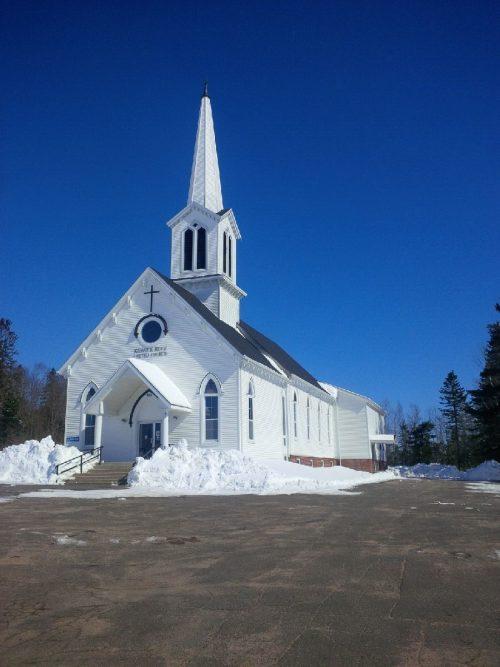 Keswick Ridge United Church during the winter thaw.